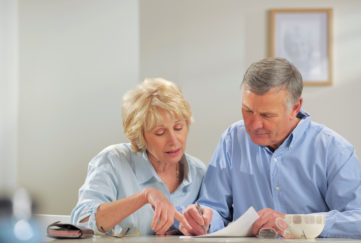 Senior couple making a will