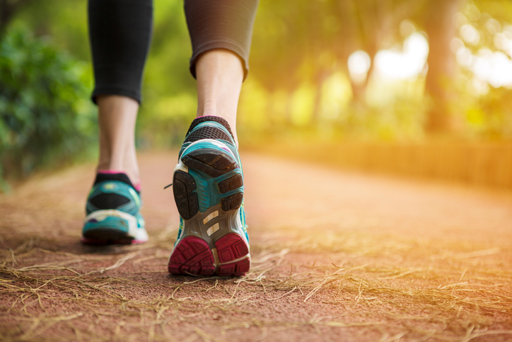 Woman running on a path close up.