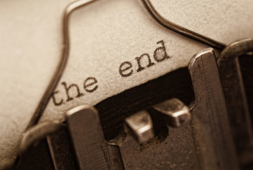 The end, words written on old vintage typewriter, sepia retro tone. the end